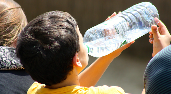 boy-drinking-bottled-water
